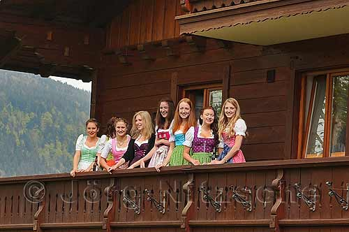 The young Madln observe their Buam at the Maypole setting up in Berchtesgaden.