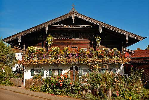 Romantic, flower-decorated wooden houses in the Chiemgau.