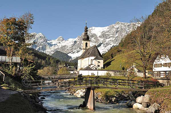 The famous postcard motif of Ramsau - view of the parish church of St. Sebastian (it was built in 1512 under Prince-Provost Gregor Rainer, the consecration of the altar took place in 1518) and the riders Alpe in the background.